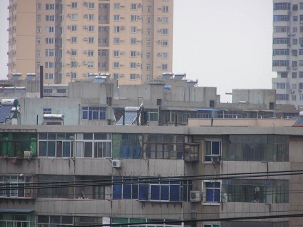 Xian China solar collectors on apartment rooftops
